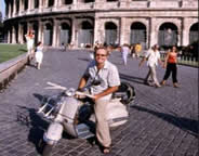 Image of Peter Moore in rome on a vintage Vespa